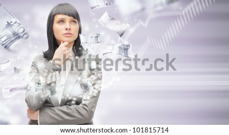 Business woman under a money rain - stock photo