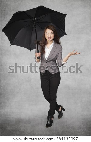 business woman under an umbrella
