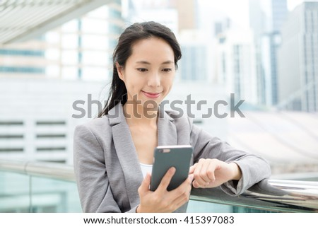 Business woman use of mobile phone