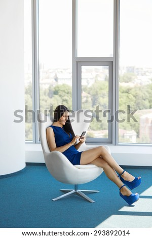 Business woman uses cell phone at office. Business people
