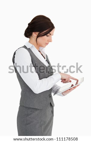 Business woman using a digital computer against white background - stock photo