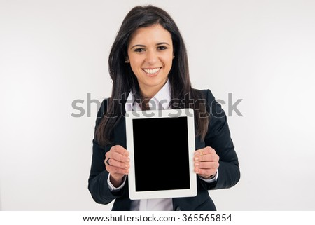 Business woman using a digital tablet - stock photo
