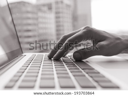 Business woman using a laptop computer. - stock photo