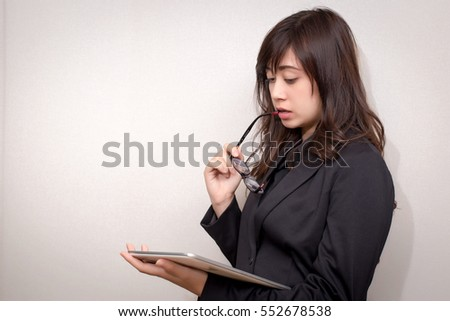 Business woman using a touch pad (tablet). concept for business.