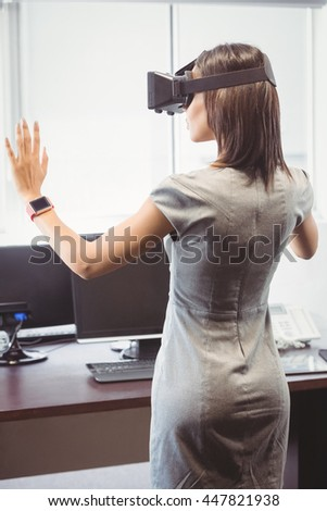 Business woman using 3D glasses in office