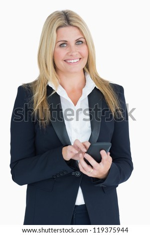 Business woman using her smartphone in the white background - stock photo