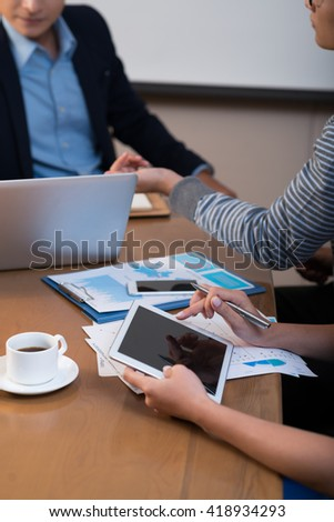 Business woman using tablet at meeting with partners
