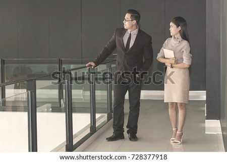Business woman walking and asking for advice his work with boos at office.