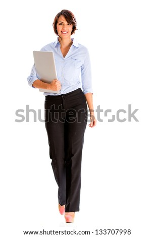 Business woman walking and carrying a laptop - isolated over white - stock photo