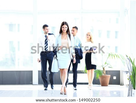 business woman walking in office building - stock photo