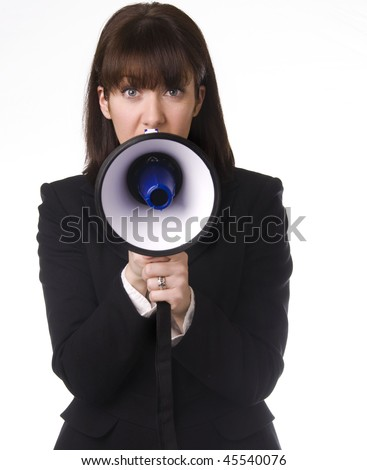 Business woman wanting to be heard holding a megaphone - stock photo