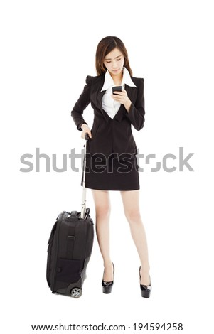 business woman watching smart phone with her  baggage - stock photo