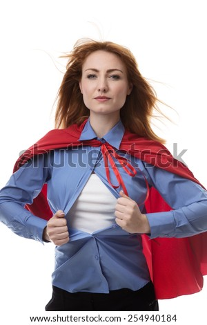 business woman wearing a super hero cape with wind in her hair - stock photo