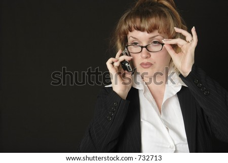 Business woman wearing glasses talking on cell phone