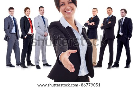 business woman welcoming to her successful business team over white. Focus on the hand of the leader