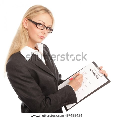 Business woman with a checklist thinking