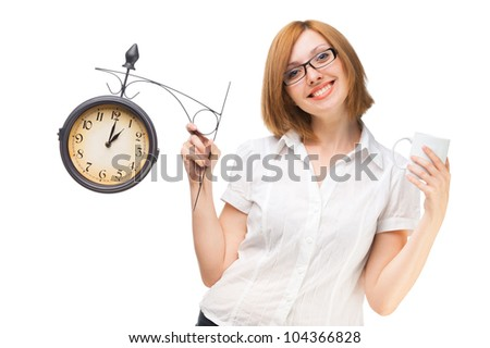 business woman with a clock and a cup in the lunch break at the office - stock photo