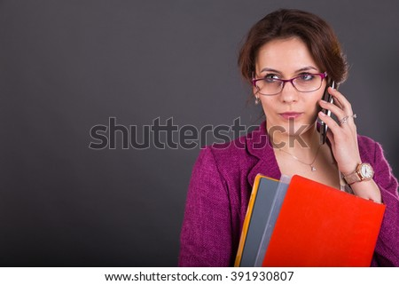 Business woman with a folder for papers and telephone