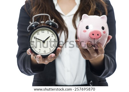 Business woman with a piggy bank to get hold dollars, is a savings concept - stock photo