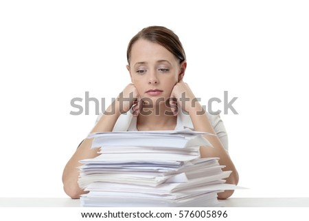 Business woman stack paper work sitting stock photo 576005896 business woman with a stack of paper work sitting on her desk at work publicscrutiny Images