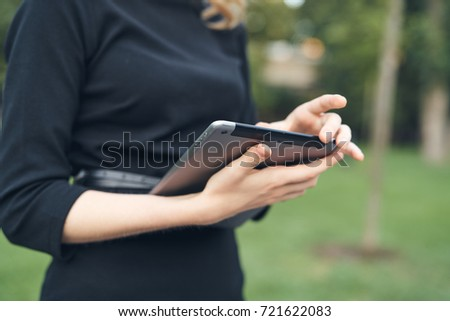business woman with a tablet on the street close up, employment