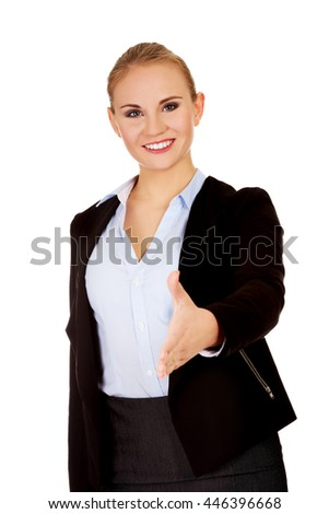 Business woman with an open hand ready for handshake  - stock photo