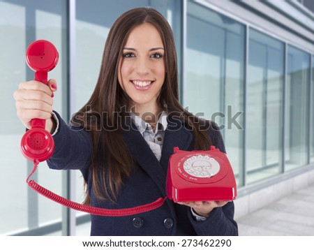 business woman with ancient phone - stock photo
