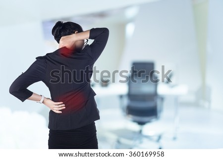 Business woman with back pain, Model is Asian woman.