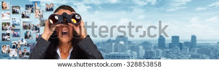 Business woman with binoculars over modern urban background. - stock photo