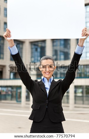 business woman with blank paper over her head, image is taken outdoors on a street