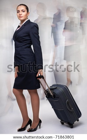 Business woman with blurred motion on the background