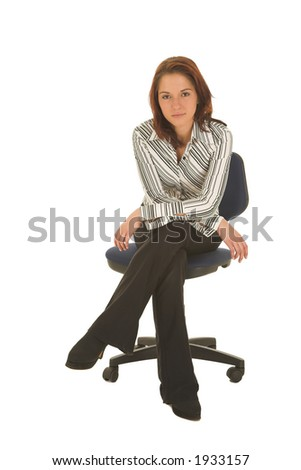 Business woman with brown hair, dressed in a white shirt with black stripes - Sitting on an office chair