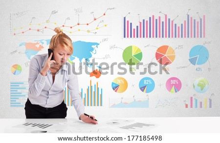 Business woman with colorful charts graphs - stock photo