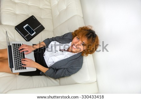 Business woman with computer at couch