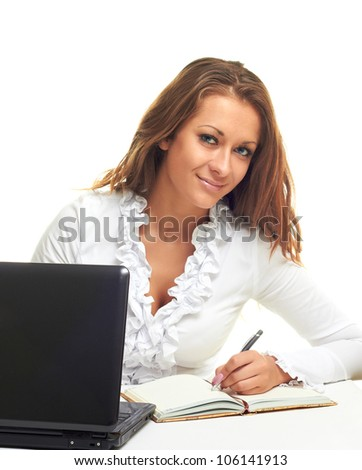 business woman with computer writes in a notebook isolated on white background