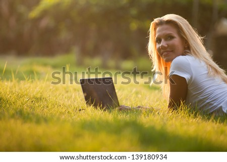business woman with computer, young girl student with the laptop outdoors - stock photo