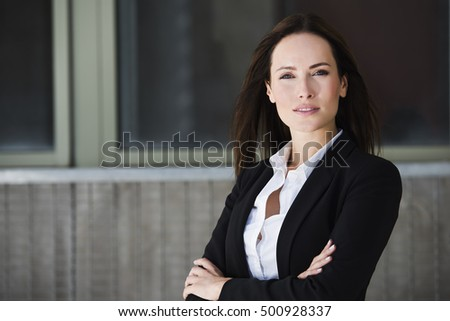 Business woman with crossed arms