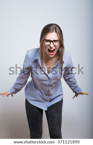 Business woman with glasses angry shouts, isolated on background - stock photo