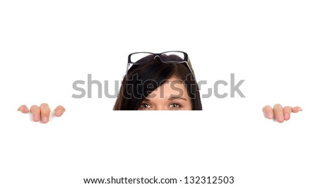 Business Woman with glasses looking over a sign / woman looking