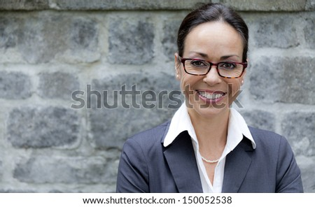 Business woman with glasses outside - stock photo