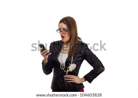 Business woman with glasses reading a shocking text message on the phone with her mouth open in disbelief.