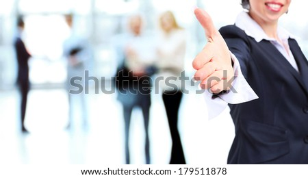 Business woman with hand extended to handshake - stock photo