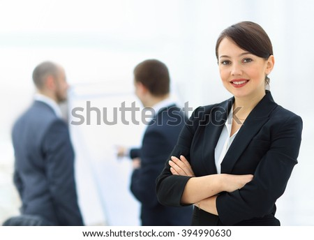 Business woman with her staff - stock photo