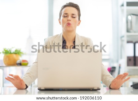 Business woman with laptop relaxing - stock photo