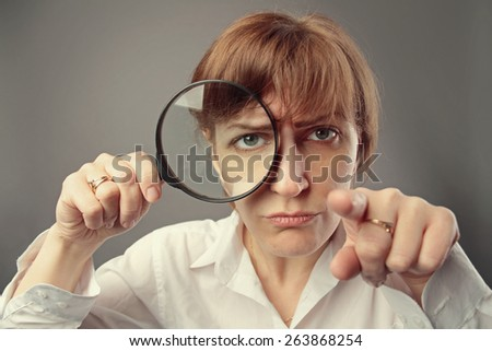 business woman with magnifying glass - stock photo