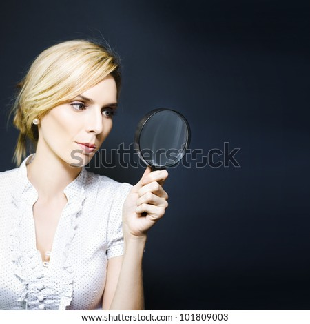 Business woman with magnifying glass, concept of a crime scene detective searching for clues, scientific research, quest for answers or conducting an inspection