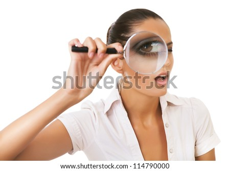 business woman with magnifying glass on eye on white background