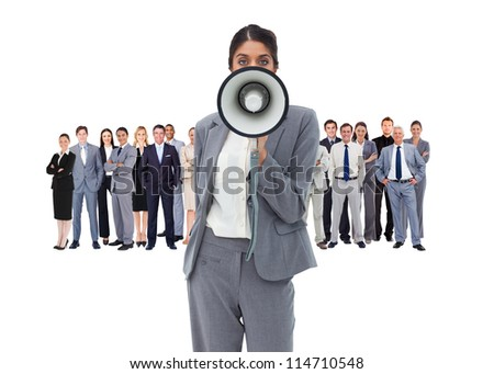 Business woman with megaphone standing in front of other busines people - stock photo