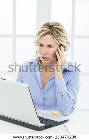 Business woman with mobile phone and computer notebook