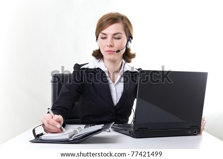 Business woman with notebook, calendar and headset.